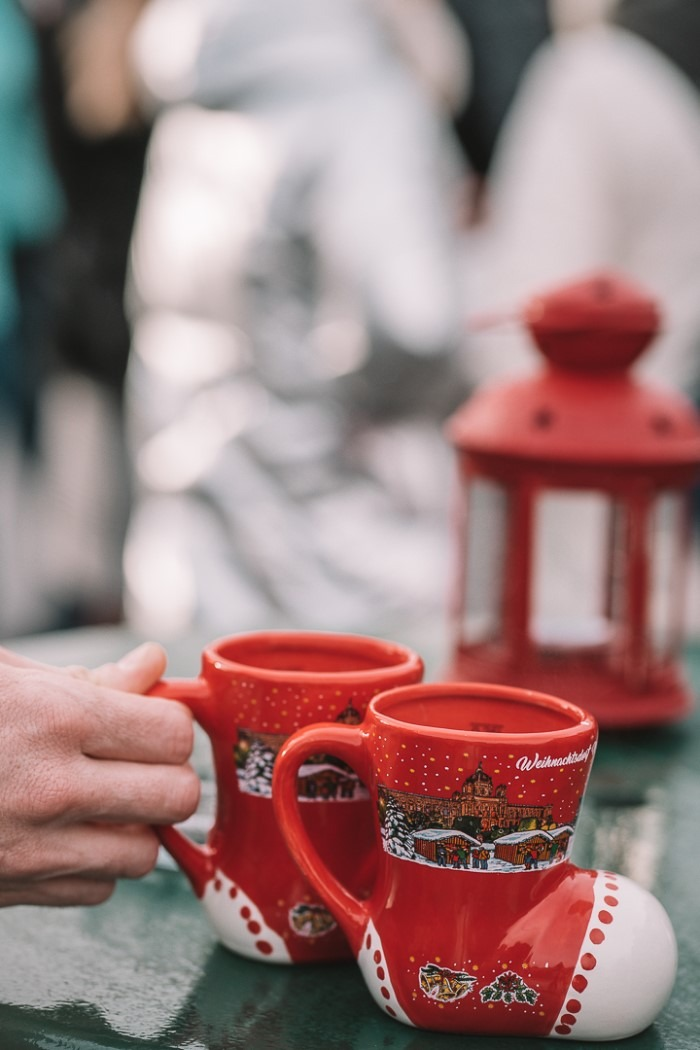 mugs of gluhwine at Vienna Christmas Market, Blue Eyed Compass