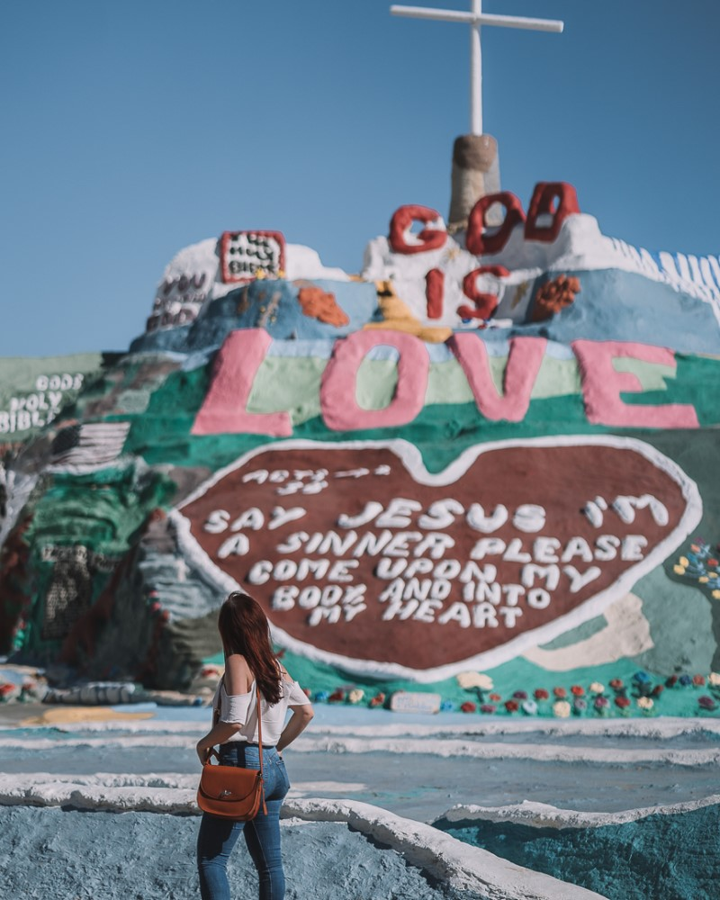 girl in front of Salvation Mountain California | Day Trips from San Diego